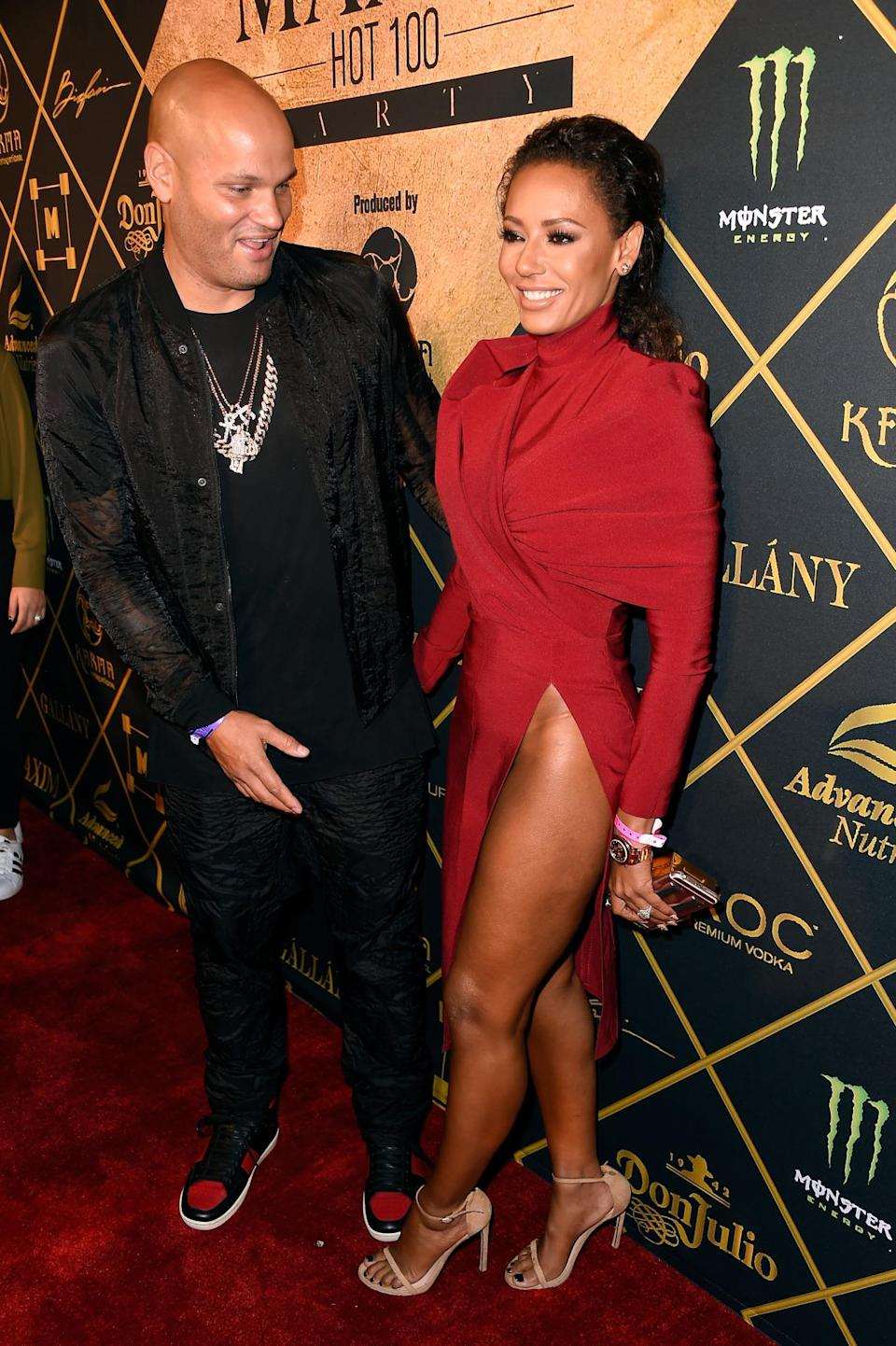<p>Former Spice Girl Mel B left little to the imagination in this side-split dress, which showed off her a whole lot of leg. <i>[Photo: Getty]</i></p>