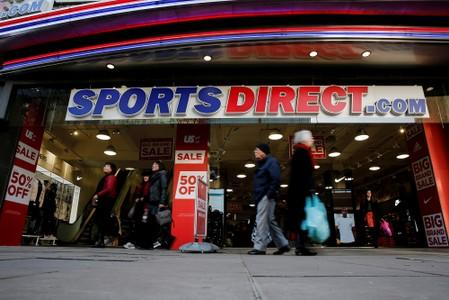 FILE PHOTO: Shoppers walk past Sports Direct store on Oxford Street in London