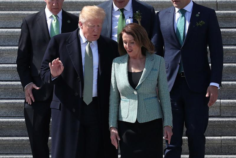 U.S. President Donald Trump talks with Speaker of the House Nancy Pelosi as they walk down the U.S. Capitol steps on March 14, 2019.