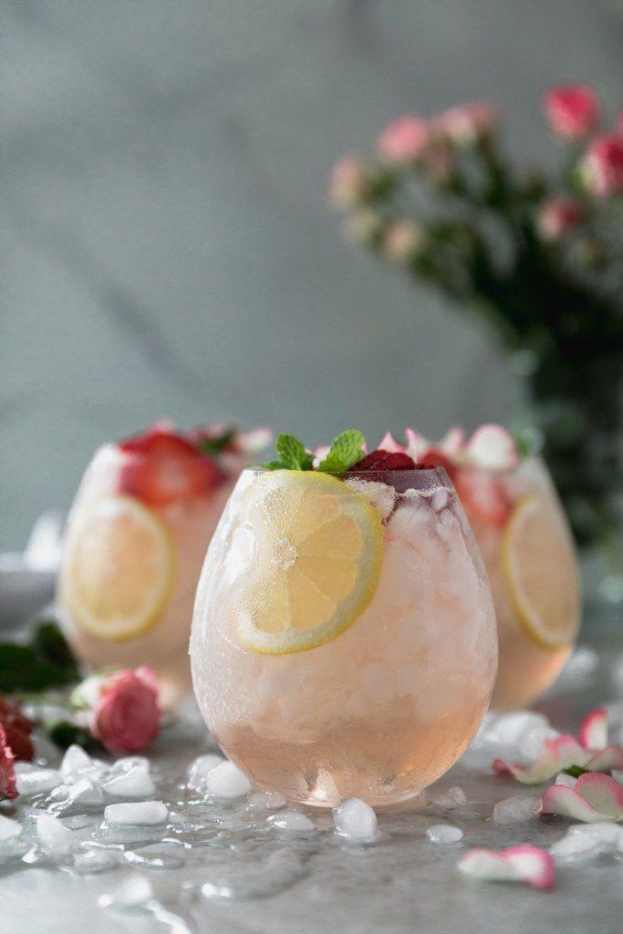 """<p>The pale pink color in this floral sangria is beautiful and will wow any crowd you serve it to.</p><p><strong>Get the recipe at <a href=""""https://www.spicesinmydna.com/rose-lemonade-elderflower-sangria/"""" rel=""""nofollow noopener"""" target=""""_blank"""" data-ylk=""""slk:Spices in My DNA"""" class=""""link rapid-noclick-resp"""">Spices in My DNA</a>.</strong></p><p><strong><strong><a class=""""link rapid-noclick-resp"""" href=""""https://www.amazon.com/Hiware-Ounces-Glass-Pitcher-Spout/dp/B06ZXRK2Q8/?tag=syn-yahoo-20&ascsubtag=%5Bartid%7C10050.g.30433150%5Bsrc%7Cyahoo-us"""" rel=""""nofollow noopener"""" target=""""_blank"""" data-ylk=""""slk:SHOP GLASS PITCHERS"""">SHOP GLASS PITCHERS</a></strong><br></strong></p>"""