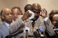 Philonise Floyd, brother of George Floyd, wipes tears from his eyes as he speaks during a news conference after former Minneapolis police Officer Derek Chauvin is convicted in the killing of George Floyd, Tuesday, April 20, 2021, in Minneapolis. (AP Photo/John Minchillo)