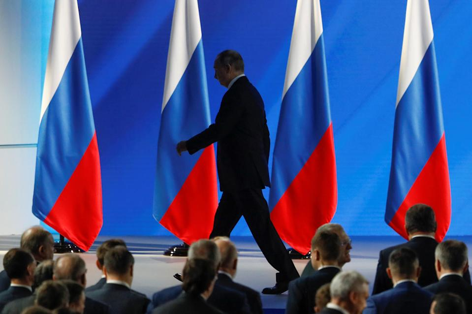 Russian President Putin leaves after delivering his address to the Federal Assembly in Moscow