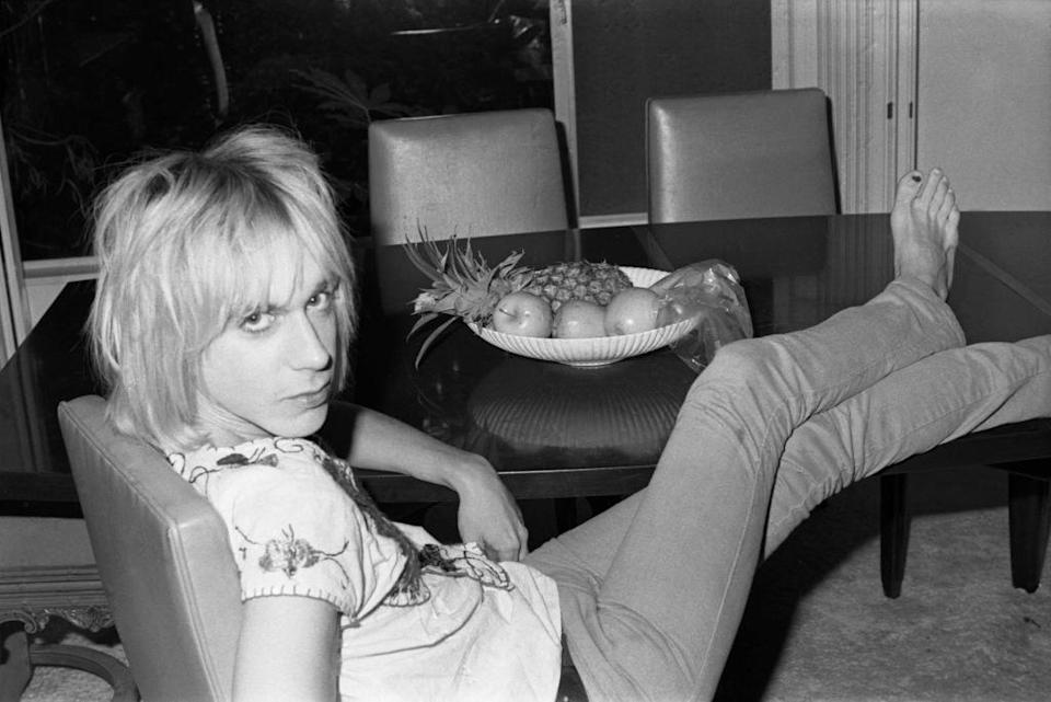A young Iggy Pop with his feet on the table