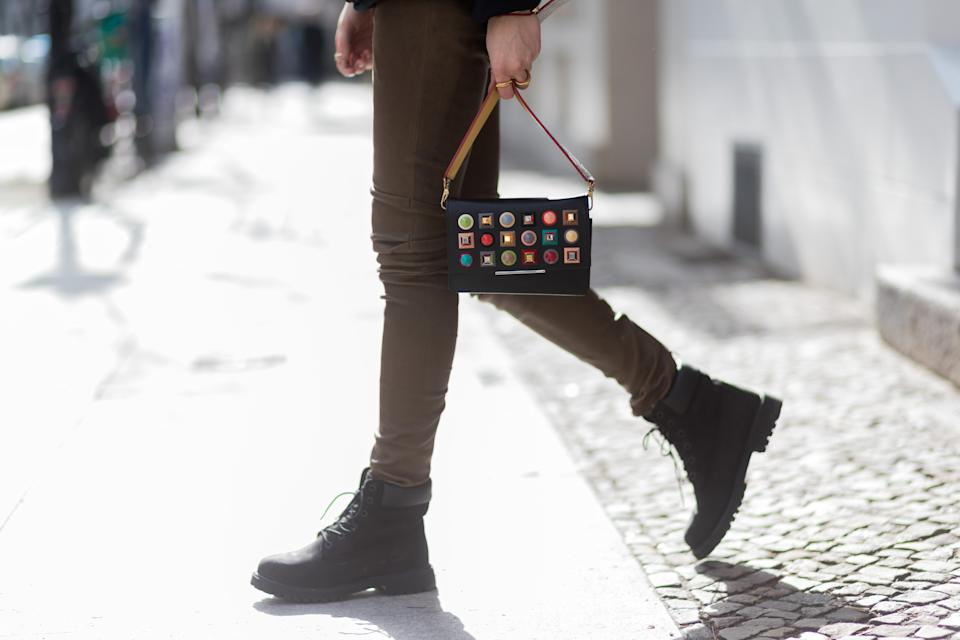 BERLIN, GERMANY - MARCH 11:  Lisa Hahnbueck wearing  Play Comme de Garcon Sweatshirt, Hironae Paris Jasper Leather Pants, Fendi Clutch bag, MCM Strap, Timberland Boots, Casio Sheen Bluetooth Watch on March 11, 2017 in Berlin, Germany. (Photo by Christian Vierig/Getty Images)