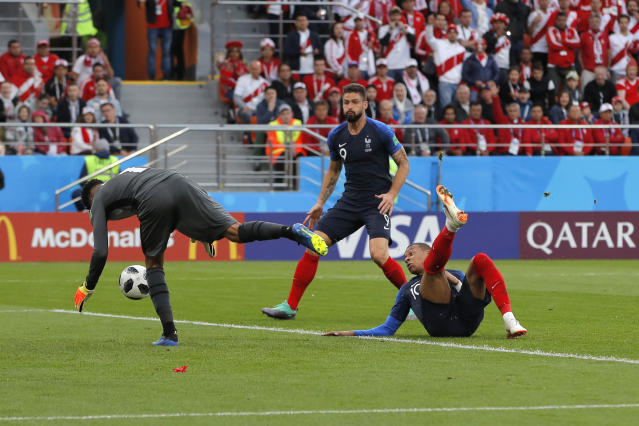 France's Kylian Mbappe, right, scores his side's opening goal during the group C match between France and Peru at the 2018 soccer World Cup in the Yekaterinburg Arena in Yekaterinburg, Russia, Thursday, June 21, 2018. (AP Photo/Vadim Ghirda)