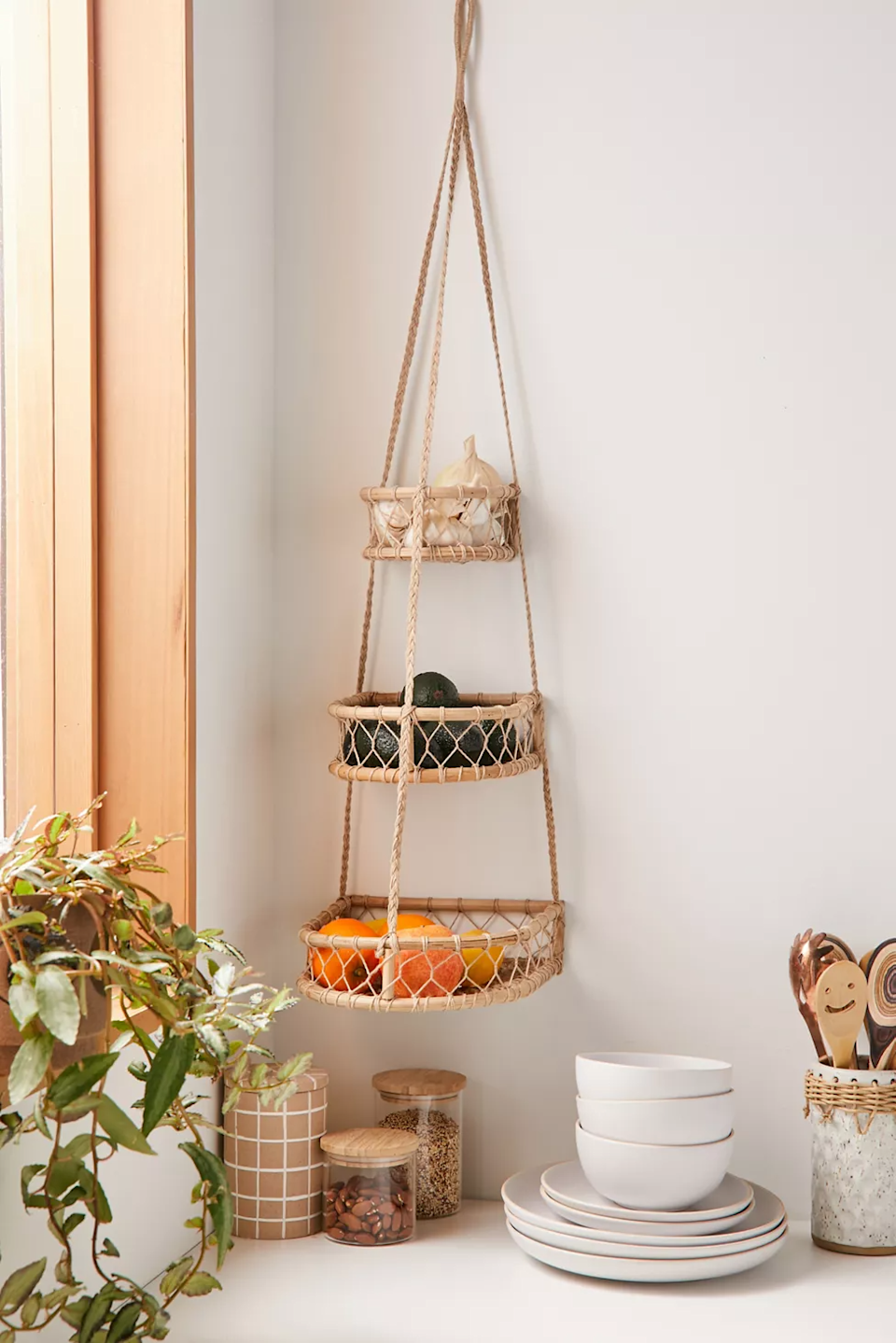 "<h3><a href=""https://www.urbanoutfitters.com/shop/molly-boho-3-tier-hanging-basket"" rel=""nofollow noopener"" target=""_blank"" data-ylk=""slk:Molly Boho 3-Tier Hanging Basket"" class=""link rapid-noclick-resp"">Molly Boho 3-Tier Hanging Basket</a></h3> <br><strong>When your kitchen countertop space is limited: </strong>Take advantage of empty wall space and hang these chic boho style woven baskets to house your fruits and veg.<br><br><strong>Wayfair</strong> Dorn Wall Storage Organizer With Baskets, Set of 2, $, available at <a href=""https://go.skimresources.com/?id=30283X879131&url=https%3A%2F%2Fwww.wayfair.com%2Fstorage-organization%2Fpdp%2Fgracie-oaks-dorn-wall-storage-organizer-with-baskets-w002755649.html"" rel=""nofollow noopener"" target=""_blank"" data-ylk=""slk:Gracie Oaks"" class=""link rapid-noclick-resp"">Gracie Oaks</a>"