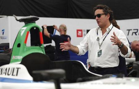 Agag, Formula E CEO, gestures next to Michela Cerruti's Formula E car in the box during an interview with Reuters in Buenos Aires