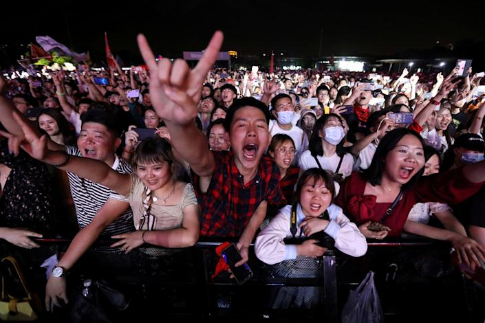 <p>Fans attend a performance of a rock band at the Strawberry Music Festival during Labour Day holiday in Wuhan, China</p> (Reuters)