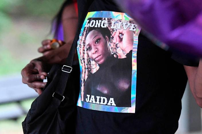 An attendee to a memorial for Jaida Peterson wears a shirt with her photo on it at Tuckaseegee Park on April 9, 2021. Police discovered the body of Peterson, 29, in a hotel room, on Easter Sunday.