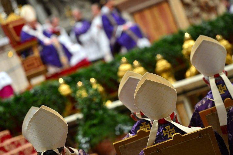 Cardinals look at Pope Benedict XVI leading the mass for Ash Wednesdayon February 13, 2013 at St Peter's Basilica