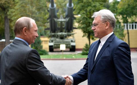 President Vladimir Putin shakes hands with Yan Novikov, director of Buk missile producer Almaz-Antey. - Credit: Alexei Nikolsky/Sputnik, Kremlin Pool Photo via AP