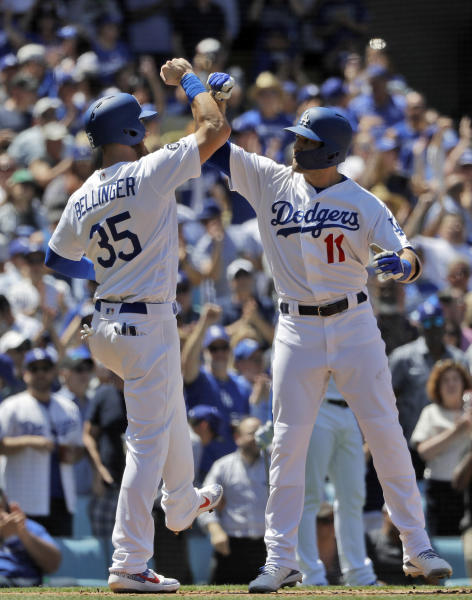 Los Angeles Dodgers' A.J. Pollock (11) celebrates his three-run home run at home plate with teammate Cody Bellinger (35) during the sixth inning of a baseball game against the Cincinnati Reds Wednesday, April 17, 2019, in Los Angeles. (AP Photo/Marcio Jose Sanchez)
