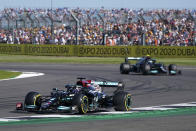 Mercedes driver Lewis Hamilton of Britain steers his car followed by Mercedes driver Valtteri Bottas of Finland during the Sprint Qualifying of the British Formula One Grand Prix, at the Silverstone circuit, in Silverstone, England, Saturday, July 17, 2021. The British Formula One Grand Prix will be held on Sunday. (AP Photo/Jon Super)