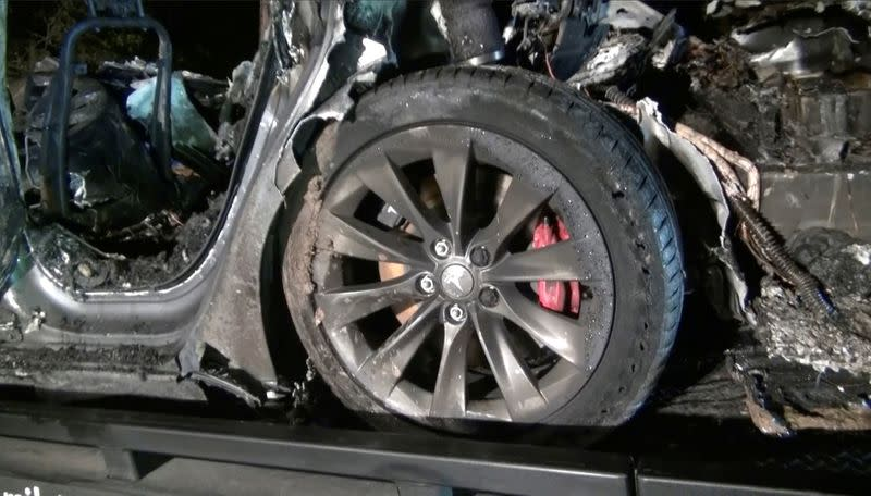 FILE PHOTO: The remains of a Tesla vehicle are seen after it crashed in The Woodlands, Texas
