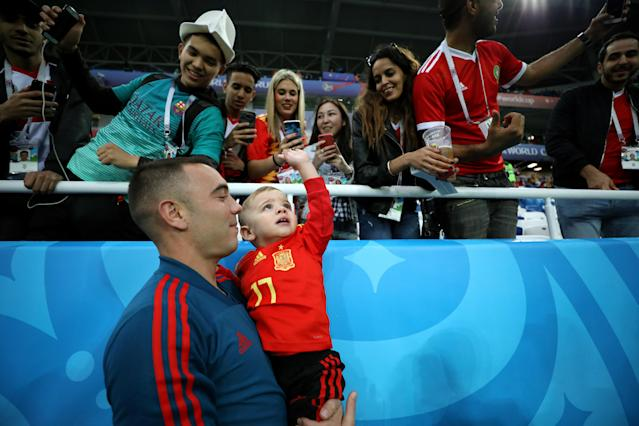 <p>Aspas of Spain speaks with his family during the warm up prior to the 2018 FIFA World Cup Russia group B match between Spain and Morocco at Kaliningrad Stadium on June 25, 2018 in Kaliningrad, Russia. (Photo by Jamie Squire – FIFA/FIFA via Getty Images) </p>