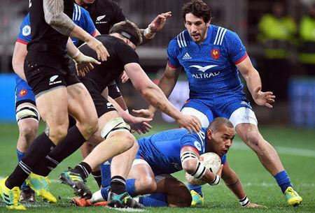 Rugby Union - June Internationals - New Zealand vs France - Forsyth Barr Stadium, Dunedin, New Zealand - June 23, 2018 - Gael Fickou of France is tackled by New Zealand players. REUTERS/Ross Setford