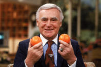 "FILE - This Aug. 4, 1981, file photo shows former Athletics baseball team owner Charles O. Finley showing off orange baseballs on ""Good Morning America."" The Athletics were given permission by then-baseball commissioner Bowie Kuhn to use the baseballs in a couple of spring training games. (AP Photo/Dave Pickoff, File)"