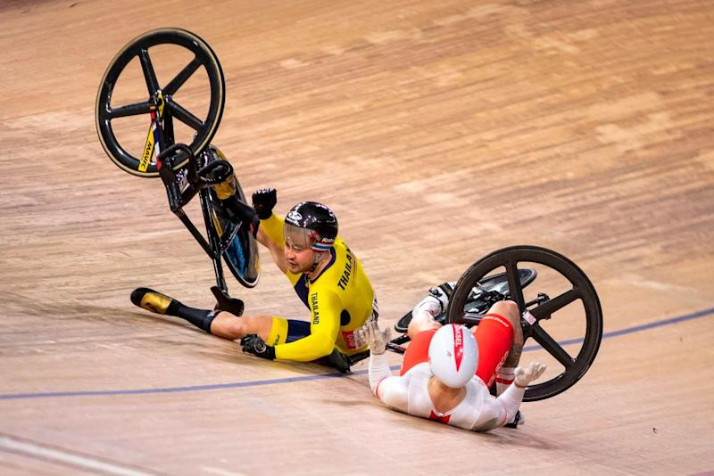 Thailands Jai Angsuthasawit L and Polands Krzysztof Maksel crash during the Kerin quarter final race at the UCI track cycling World Championship at the velodrome in Berlin on February 27 2020 Photo by Odd ANDERSEN AFP Photo by ODD ANDERSENAFP via Getty Images