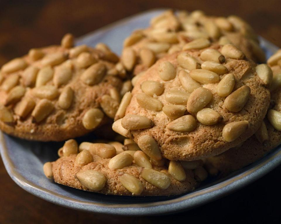 """<p>Italian cookies of all sorts, whether pignolis, biscotti, amaretti or rainbow cookies, can be found in family-owned bakeries throughout New Jersey. Residents fill up a box and show up at gatherings with them throughout the year, and the holiday season is no exception.</p><p>Get the recipe from <a href=""""https://www.delish.com/cooking/a1110/pignoli-cookies-recipes/"""" rel=""""nofollow noopener"""" target=""""_blank"""" data-ylk=""""slk:Delish"""" class=""""link rapid-noclick-resp"""">Delish</a>.</p>"""