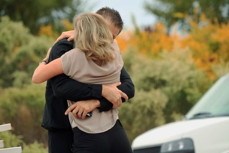 People embrace before the funeral of Dawna Ray Langford and her two children, members of the Mexican-American Mormon community killed by unknown assailants, in La Mora