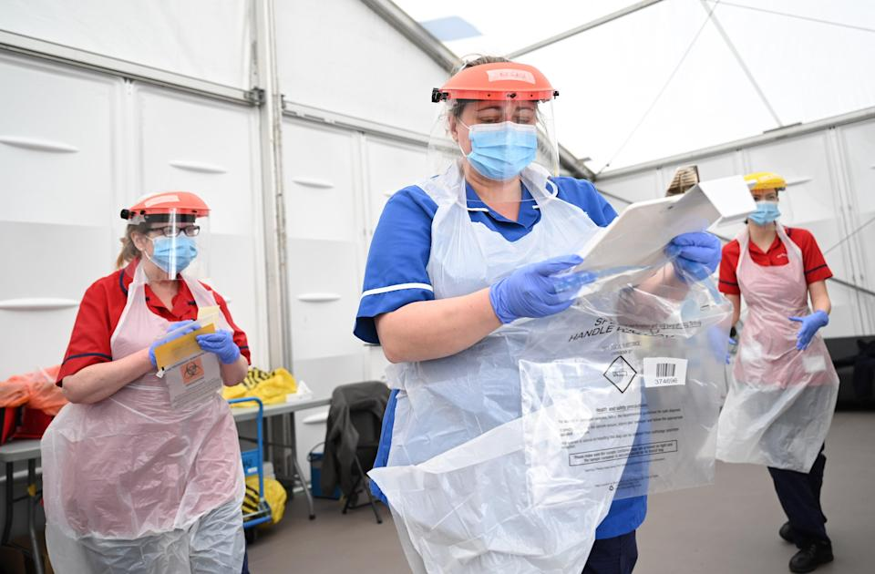 <p>NHS staff have had to face many obstacles over the last 12 months</p> (POOL/AFP via Getty Images)