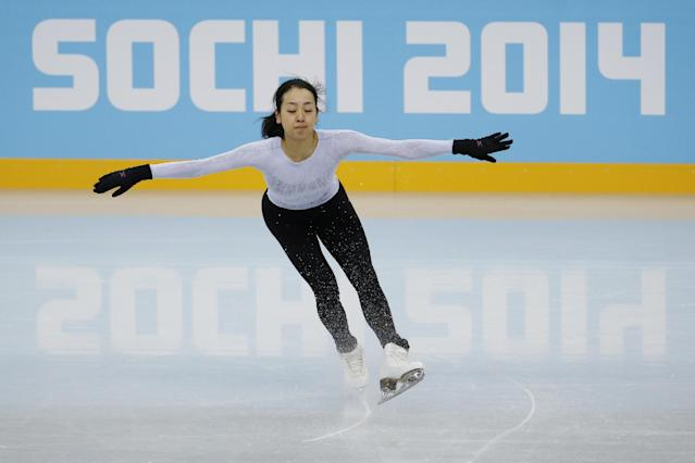 Mao Asada of Japan skates during a practice session at the figure stating practice rink at the 2014 Winter Olympics, Tuesday, Feb. 18, 2014, in Sochi, Russia. (AP Photo/Bernat Armangue)