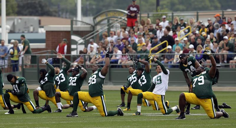 Green Bay Packers players stretch during NFL football training camp Tuesday, July 30, 2013, in Green Bay, Wis. (AP Photo/Morry Gash)