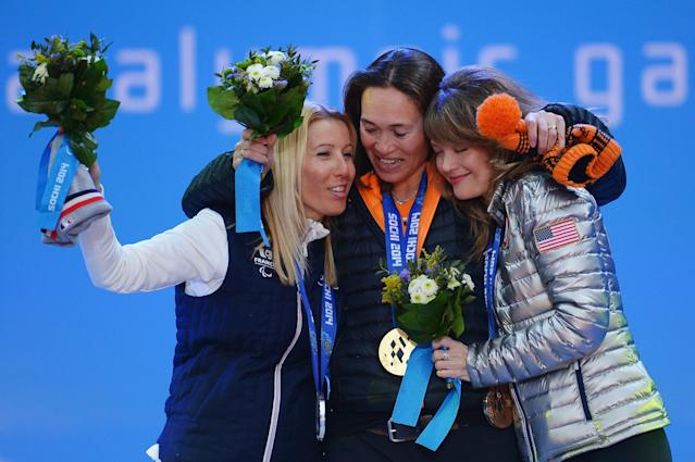 SOCHI, RUSSIA - MARCH 14: (L-R) Silver medalist Cecile Hernandez Cervellon of France, gold medalist Bibian Mentel-Spee of Netherlands and bronze medalist Amy Purdy of the United States celebrate during the medal ceremony for Women's Snowboard Cross Standing on day seven of the Sochi 2014 Paralympic Winter Games on March 14, 2014 in Sochi, Russia. (Photo by Dennis Grombkowski/Getty Images)