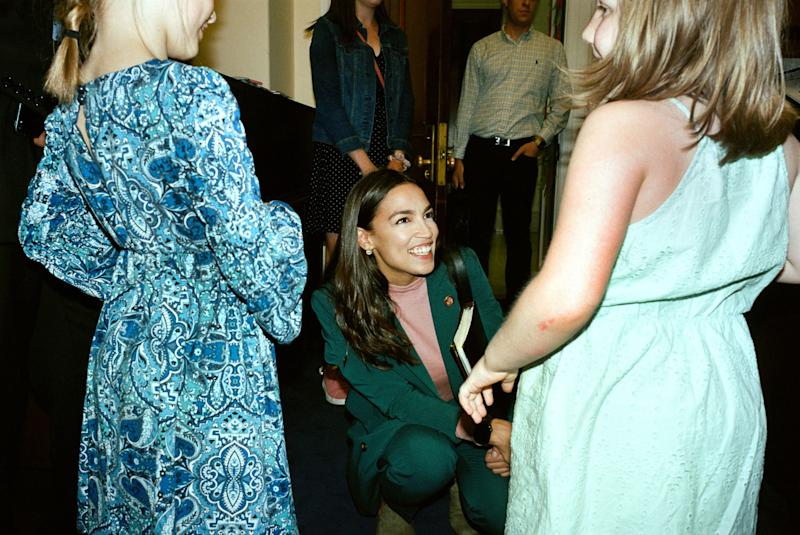 """AOC greets young relatives of the chief of staff of Rep. Earl Blumenauer (D-OR). """"Make sure you keep this experience in mind,"""" she says."""