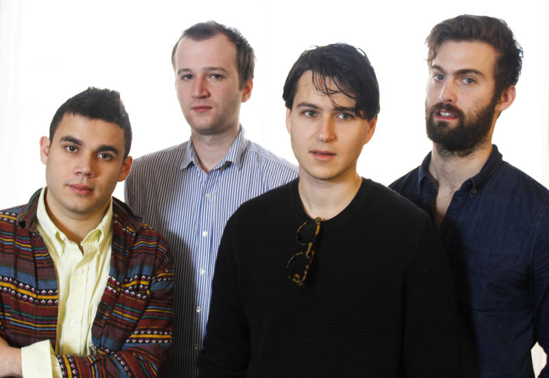 """This March 14, 2013 photo shows members of the band Vampire Weekend, from left, Rostam Batmanglij, Chris Baio, Ezra Koenig, and Chris Thomson posing during the SXSW Music Festival in Austin, Texas. The band's latest album, """"Modern Vampires of the City,"""" was released on Tuesday. (Photo by Jack Plunkett/Invision/AP)"""