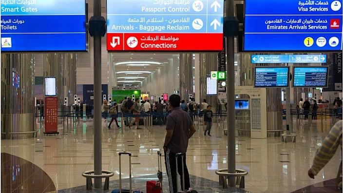 A man is looking at the immigration section of Dubai Airport