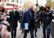 FILE PHOTO: EU chief Brexit negotiator Barnier arrives for a meeting in London