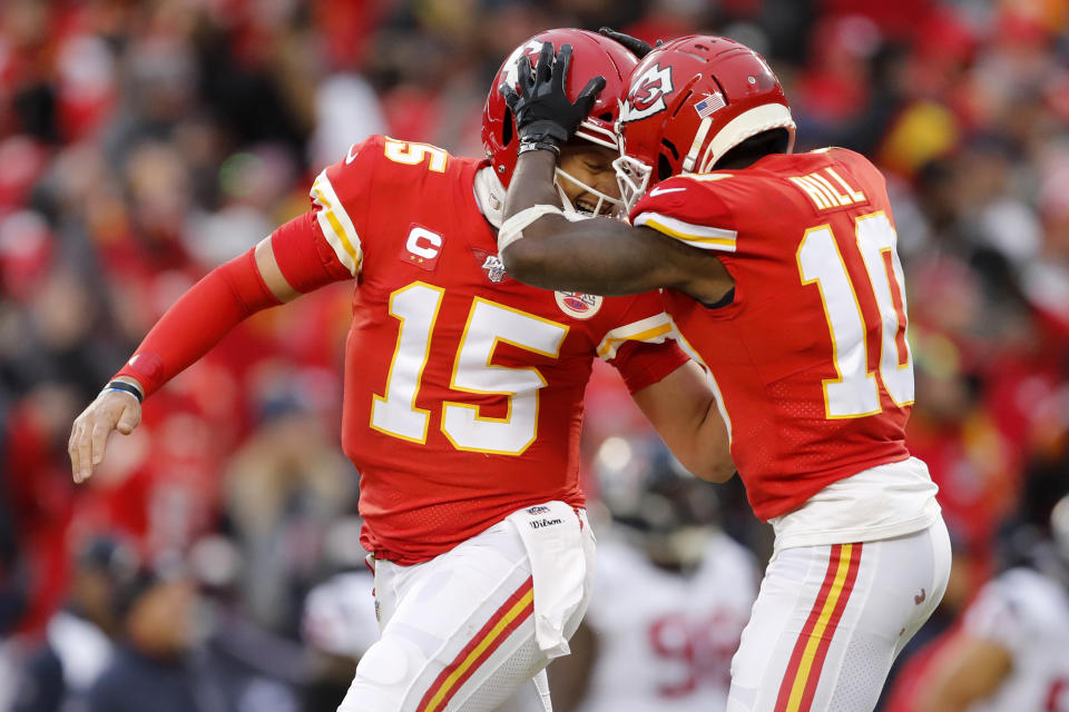 Kansas City Chiefs quarterback Patrick Mahomes (15) celebrates with wide receiver Tyreek Hill (10) during the first half of an NFL divisional playoff football game against the Houston Texans, in Kansas City, Mo., Sunday, Jan. 12, 2020. (AP Photo/Jeff Roberson)