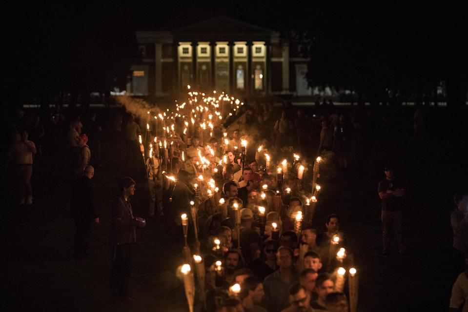 """<p>Chanting """"White lives matter! You will not replace us! and Jews will not replace us!,"""" several hundred white nationalists and white supremacists carrying torches marched in a parade through the University of Virginia campus in Charlottesville, Va., on Aug. 11, 2017. (Photo: Evelyn Hockstein/For The Washington Post via Getty Images) </p>"""