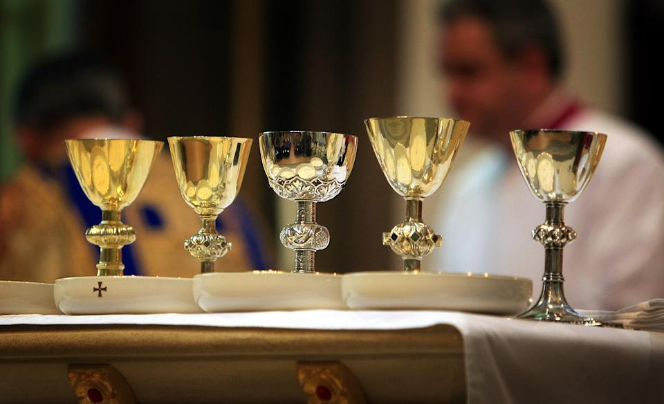 The communion wine and bread is prepared during the Most Reverend Bernard Longley installation of the Most Reverend Bernard Longley as Archbishop of Birmingham at St Chad's Cathedral in the city.   (Photo by David Jones/PA Images via Getty Images)