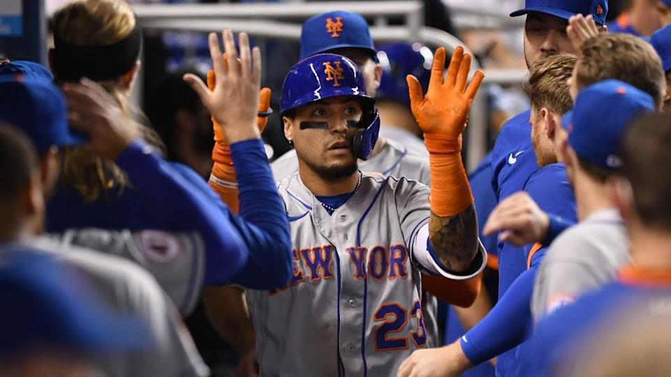 Baez high fives teammates in dugout in Miami road greys