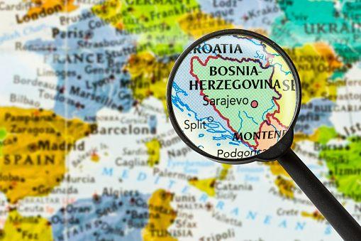 map of Bosnia and Herzegovina through magnifying glass (Photo: naruedom via Getty Images/iStockphoto)