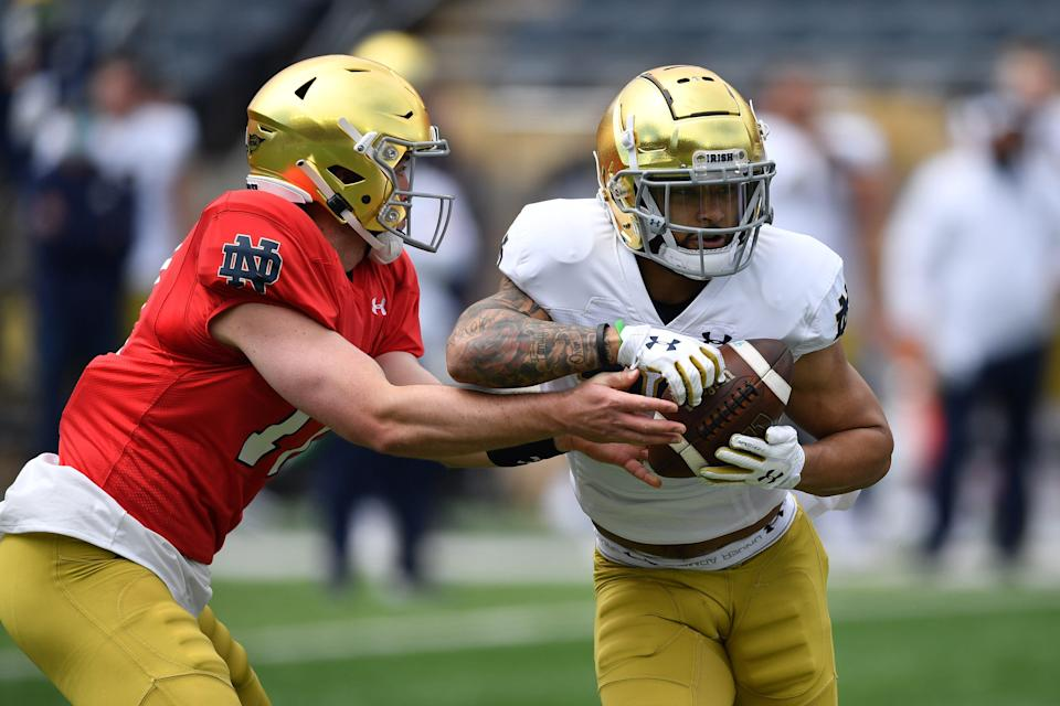Notre Dame quarterback Jack Coan hands off to running back Kyren Williams in the first quarter of May's Blue-Gold Game at Notre Dame Stadium.