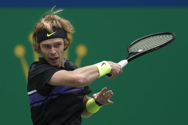 Andrey Rublev, of Russia watches his shot as he plays against Borna Coric of Croatia in their men's singles match at the Shanghai Masters tennis tournament at Qizhong Forest Sports City Tennis Center in Shanghai, China Tuesday, Oct. 8, 2019. (AP Photo/Andy Wong)