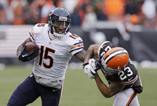 """FILE - In this Dec. 15, 2013 file photo, Chicago Bears wide receiver Brandon Marshall (15) pushes Cleveland Browns cornerback Joe Haden (23) away after a catch in the second quarter of an NFL football game, in Cleveland. The Bears have agreed to terms with Pro Bowl wide receiver Brandon Marshall on a three-year contract extension. It is worth a reported $30 million, and Marshall's foundation tweeted Monday, May 19, 2014, that he was donating $1 million to the """"mental health community."""" (AP Photo/Tony Dejak, File)"""