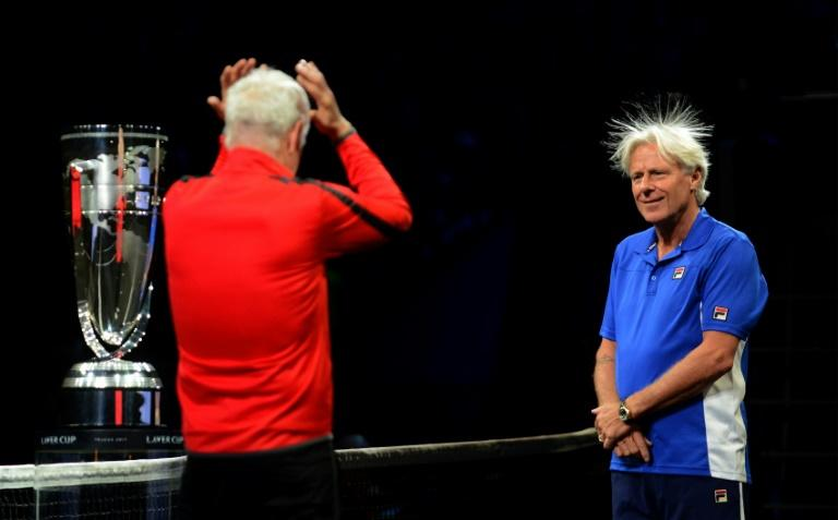 Swedish Bjorn Borg, captain of Team Europe and US John Mcenroe, captain of Team World react during the line up at the start at the start of the  first day of Laver Cup on September 22, 2017 in Prague