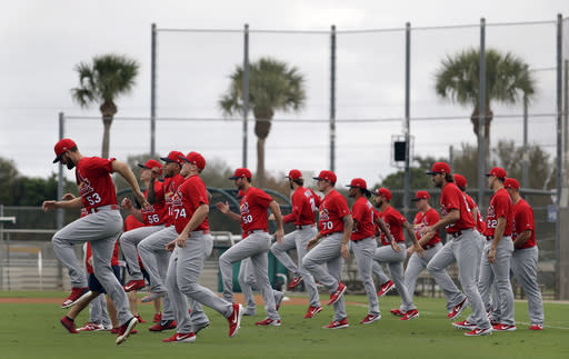 St. Louis Cardinals pitchers warm up at the start of spring training baseball practice Wednesday, Feb. 13, 2019, in Jupiter, Fla. (AP Photo/Jeff Roberson)