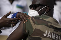 A member of the Army Forces receives a dose of the China's Sinopharm vaccine during the start of the vaccination campaign against the COVID-19 at the Health Ministry in Dakar, Senegal, Tuesday, Feb. 23, 2021. The country is also expecting nearly 1.3 million vaccine doses through the COVAX initiative. (AP Photo/Leo Correa)