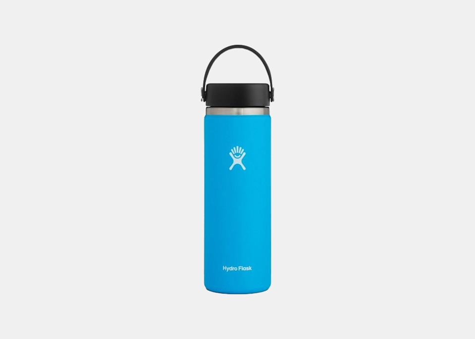 """Staying hydrated is key if you're staying active from park open to close, and bottled water will sweat all over your bag and get lukewarm fast, on top of being bad for the environment. Hydro Flask's insulated <a href=""""https://www.cntraveler.com/gallery/best-reusable-water-bottles-stainless-insulated?mbid=synd_yahoo_rss"""" rel=""""nofollow noopener"""" target=""""_blank"""" data-ylk=""""slk:reusable bottle"""" class=""""link rapid-noclick-resp"""">reusable bottle</a> will keep your drink cold for hours and has a wide-mouth lid for easy transfer of ice from counter-service drinks; it's a staple on any Disney packing list. $38, Hydro Flask. <a href=""""https://www.hydroflask.com/20-oz-wide-mouth?color=pineapple"""" rel=""""nofollow noopener"""" target=""""_blank"""" data-ylk=""""slk:Get it now!"""" class=""""link rapid-noclick-resp"""">Get it now!</a>"""
