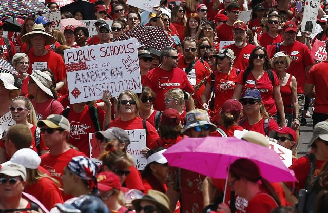 <p>Thousands march to the Arizona Capitol for higher teacher pay and public school funding on the first day of a state-wide teachers strike Thursday, April 26, 2018, in Phoenix. (Photo: Ross D. Franklin/AP) </p>