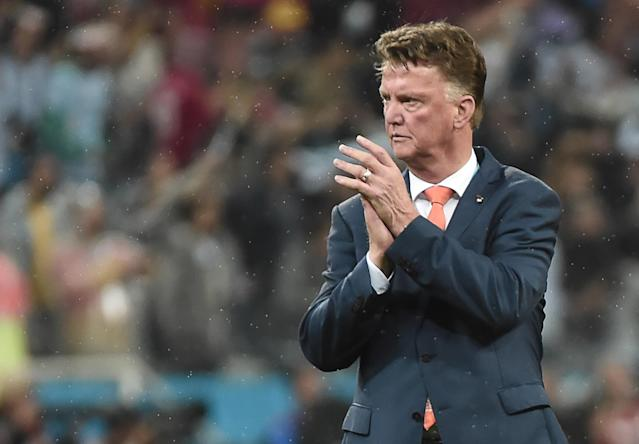 Netherlands' coach Louis van Gaal applauds after the semi-final football match between Netherlands and Argentina of the FIFA World Cup at The Corinthians Arena in Sao Paulo on July 9, 2014 (AFP Photo/Damien Meyer)