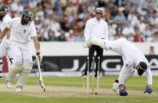 Hashim Amla (left) is run out by England's wicketkeeper Matt Prior