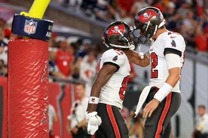 TAMPA, FLORIDA - SEPTEMBER 09: Antonio Brown #81 and Tom Brady #12 of the Tampa Bay Buccaneers celebrate their touchdown during the second quarter against the Dallas Cowboys at Raymond James Stadium on September 09, 2021 in Tampa, Florida. (Photo by Mike Ehrmann/Getty Images)