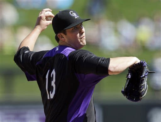 Colorado Rockies starting pitcher Drew Pomeranz throws to the Kansas City Royals during the second inning of a spring training baseball game Thursday, March 8, 2012, in Scottsdale, Ariz. (AP Photo/Marcio Jose Sanchez)