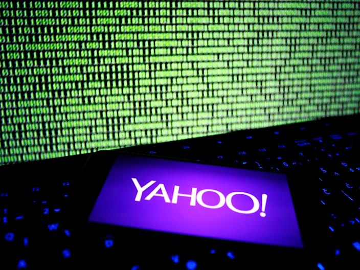 FILE PHOTO: A photo illustration shows a Yahoo logo on a smartphone in front of a displayed cyber code and keyboard on December 15, 2016. REUTERS/Dado Ruvic/Illustration